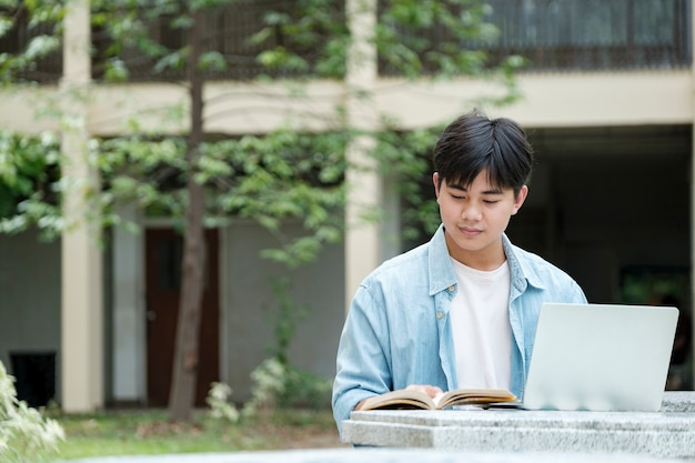 Young collage student using computer and mobile device studying online. education and online learning.