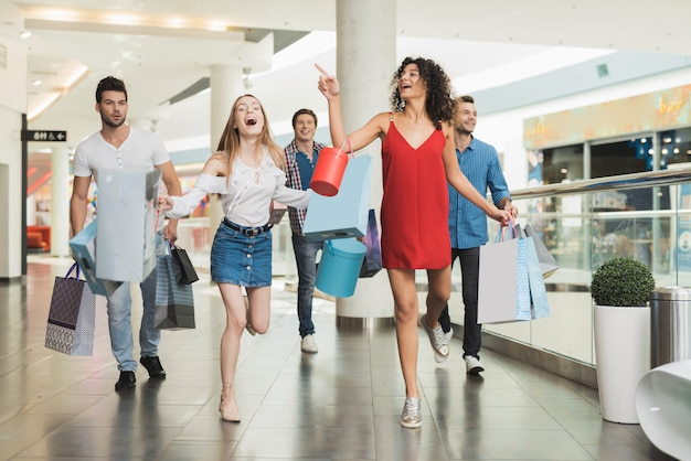 Young company shopping at the mall  black friday