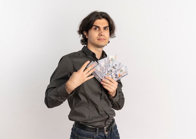 Young confident handsome caucasian man holds money and gestures four with fingers isolated on white background with copy space