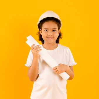 Young construction worker holding project