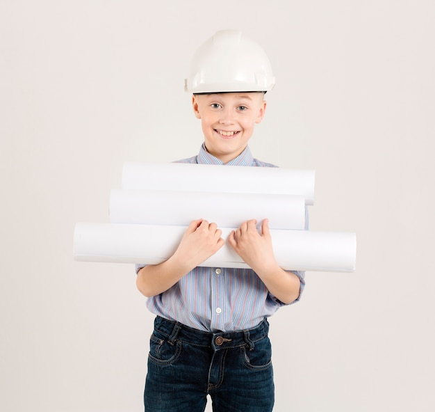 Young construction worker holding projects