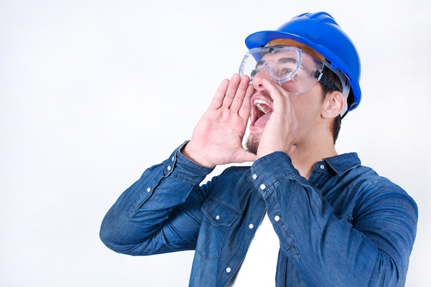 Young construction worker screaming isolated  with copy space