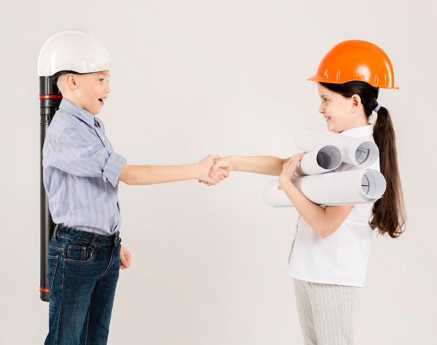 Young construction workers working together