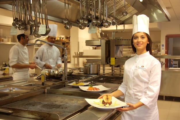 Young cook in a kitchen of a restaurant