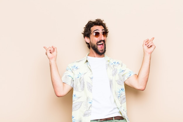 Young cool bearded man celebrating a success