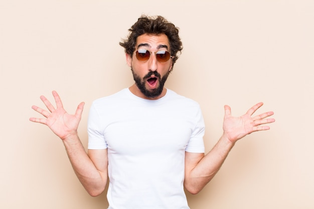 Young cool bearded man shocked or surprised