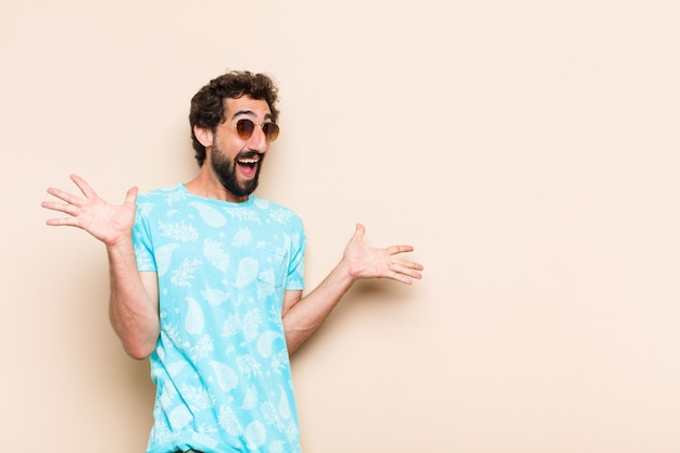 Young cool bearded man surprised expression
