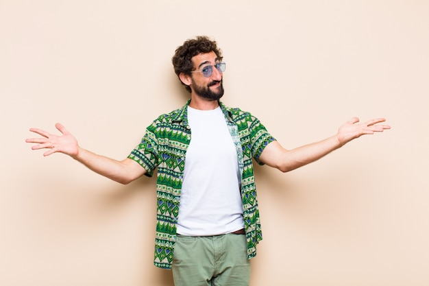 Young cool bearded man welcoming gesture