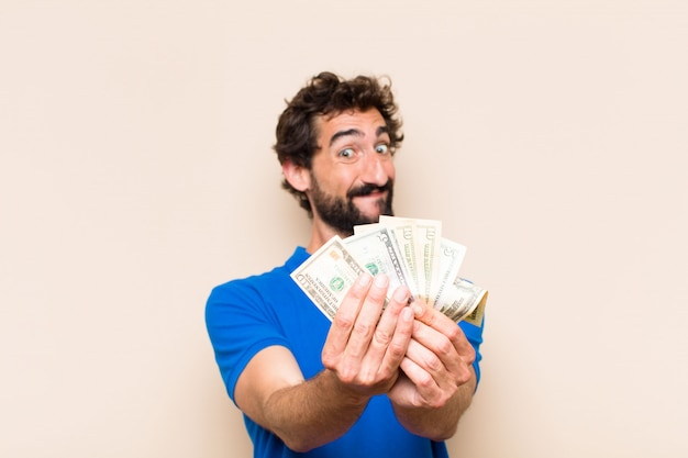 Young cool bearded man with dolar banknotes