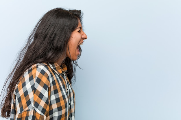Young cool indian woman shouting
