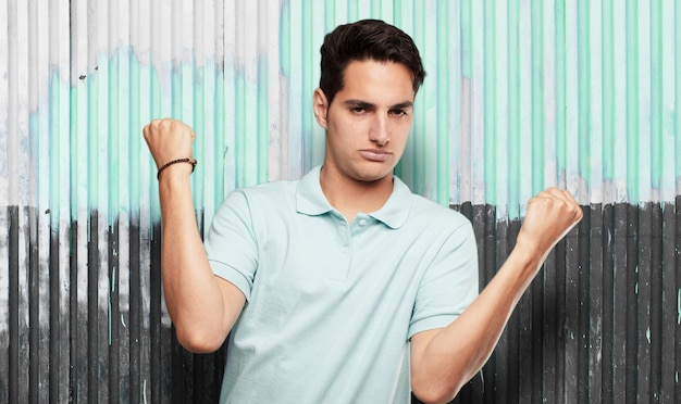 Young cool man against grunge background