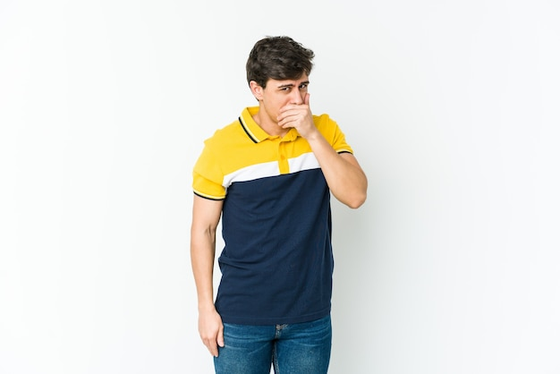 Young cool man covering mouth with hands looking worried.