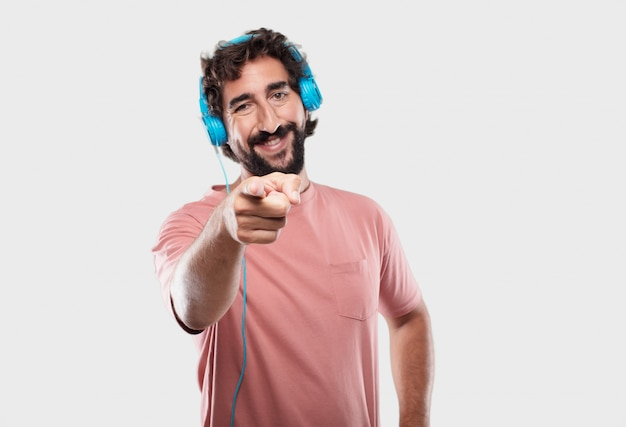 Young cool man expressing with headphones