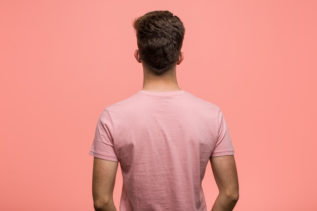 Young cool man from behind, looking back