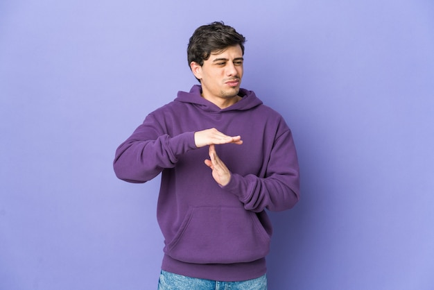 Young cool man showing a timeout gesture