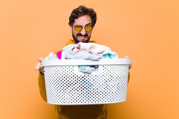 Young cool man with the laundry basket