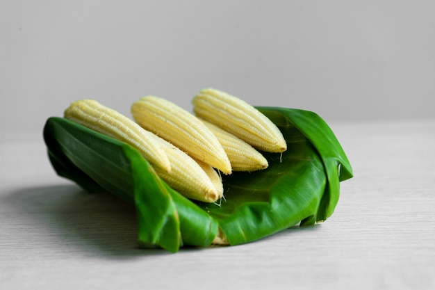 Young corn in a banana leaf. eco friendly packaging