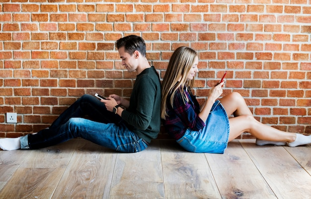 Young couple addicted to smartphone and social media