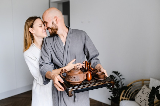 A young couple are preparing for the chinese tea ceremony