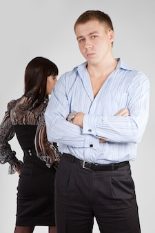 Young couple are standing back to back having relationship difficult