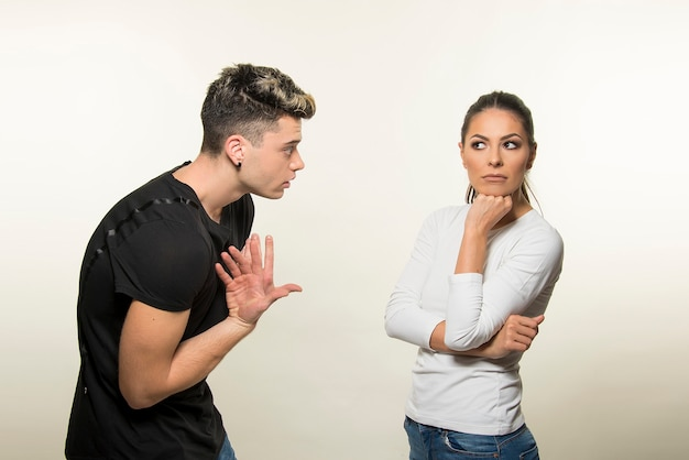 Young couple arguing isolated on white background