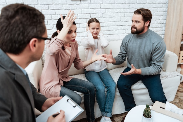 Young couple arguing at psychological therapy