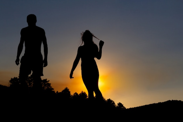 Young couple backlit at sunset. copy space. autumn.