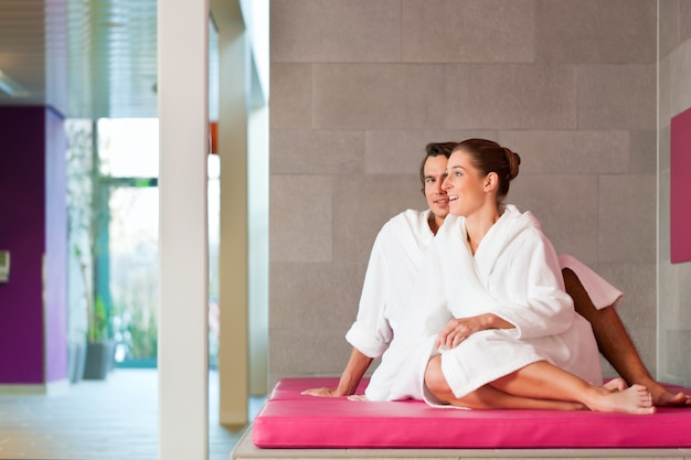 Young couple in bathrobe in spa
