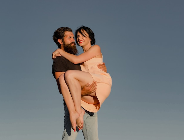 Young couple on blue sky