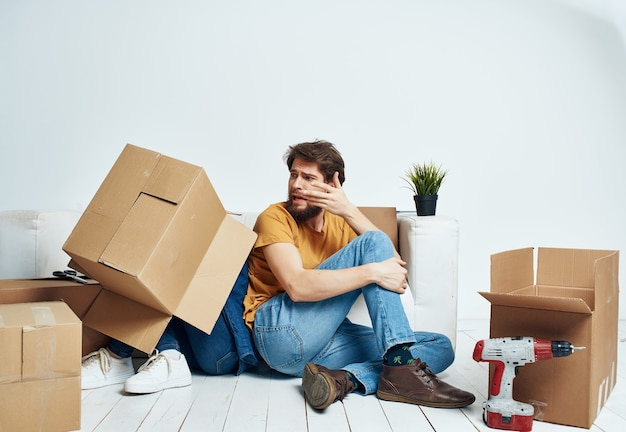 Young couple boxes with things new housing family