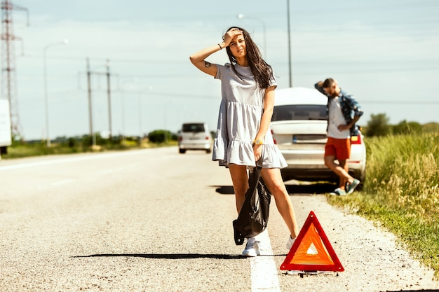 A couple in need of roadside assistance