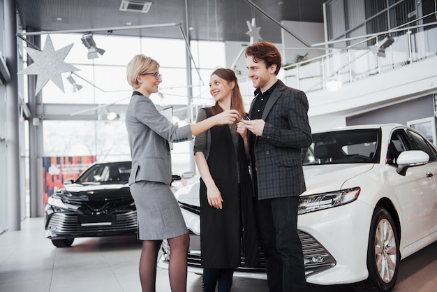 A young couple buys a new car. diller gives them kay