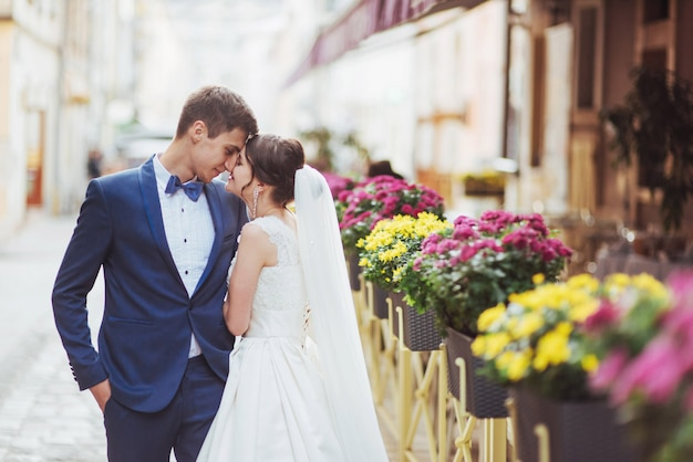 Young couple at the cafe with flowers