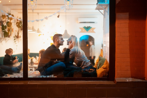 Young couple in cafe with stylish interior