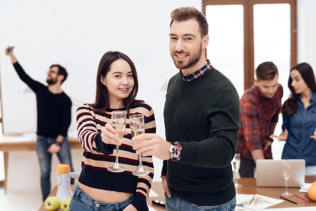 A young couple celebrates at a corporate celebration