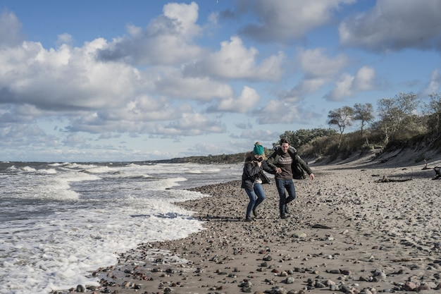 Young couple of the cold baltic sea