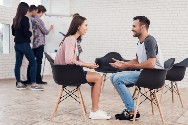 Young couple communicates with each other.