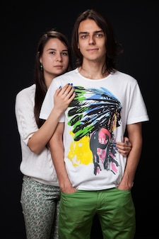 Young couple on dark