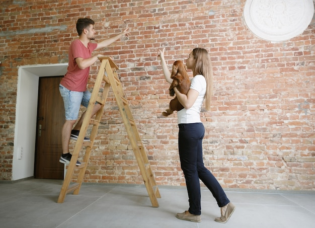 Young couple doing apartment repair together themselves. married man and woman doing home makeover or renovation