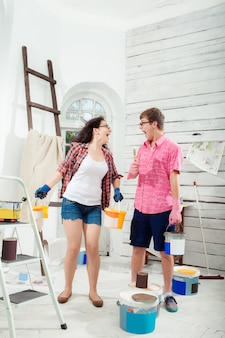 Young couple doing repair at home