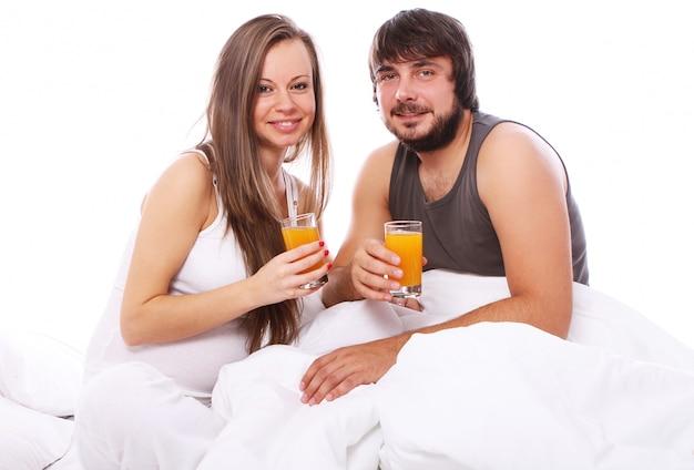 Young couple drinking orange juice