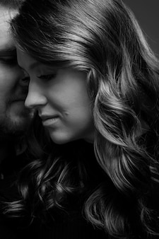 Young couple embrace tenderly and sensually.