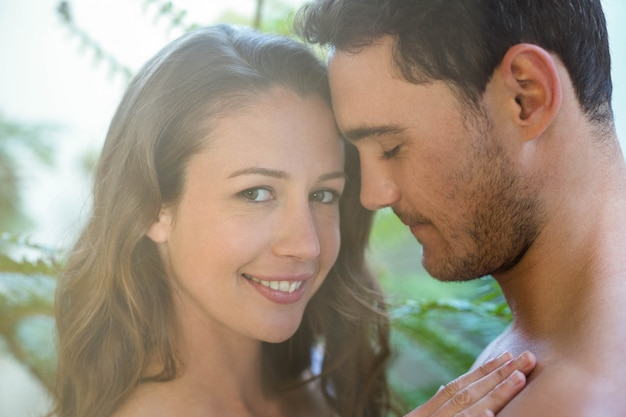 Young couple embracing passionately in garden