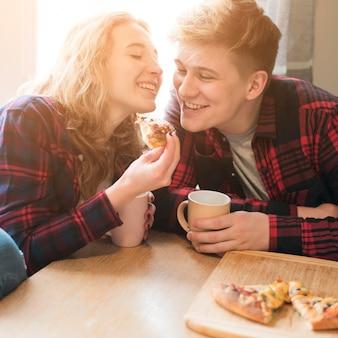 Young couple enjoying pizza