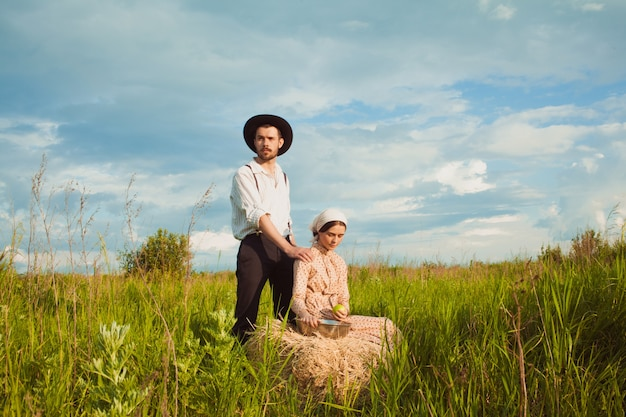 Young couple of farmers in the field.