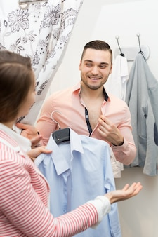 Young couple at fitting room