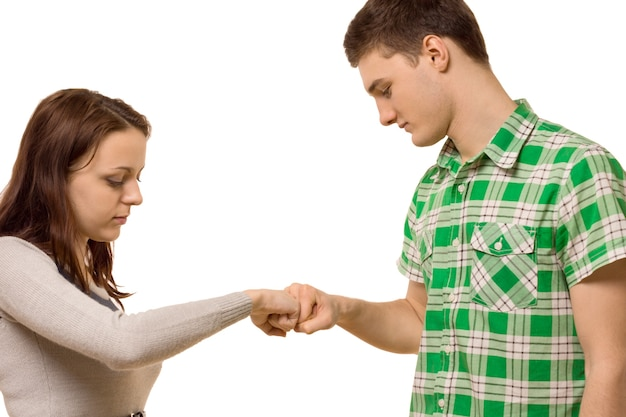 Young couple gently knocking knuckles