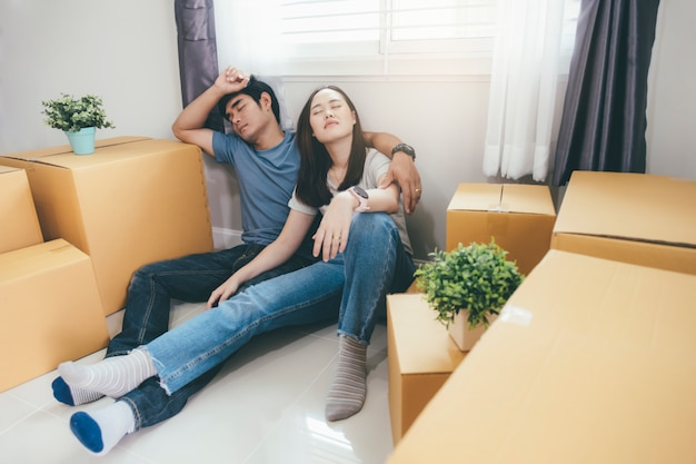 Young couple get tried after their are moving to a new house.