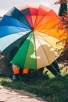 Young couple of girls. girls in love with lgbt umbrella.