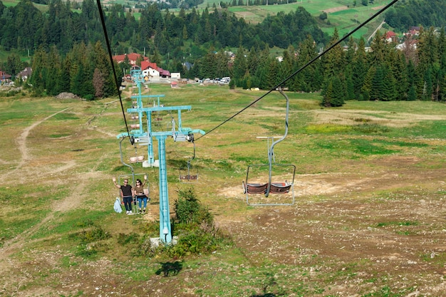 Young couple going up on ski lift